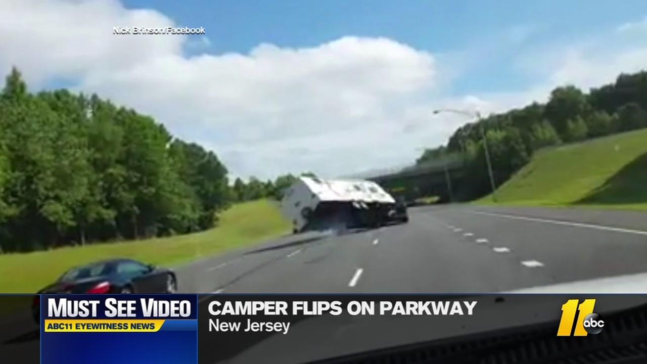 Camper flips on highway