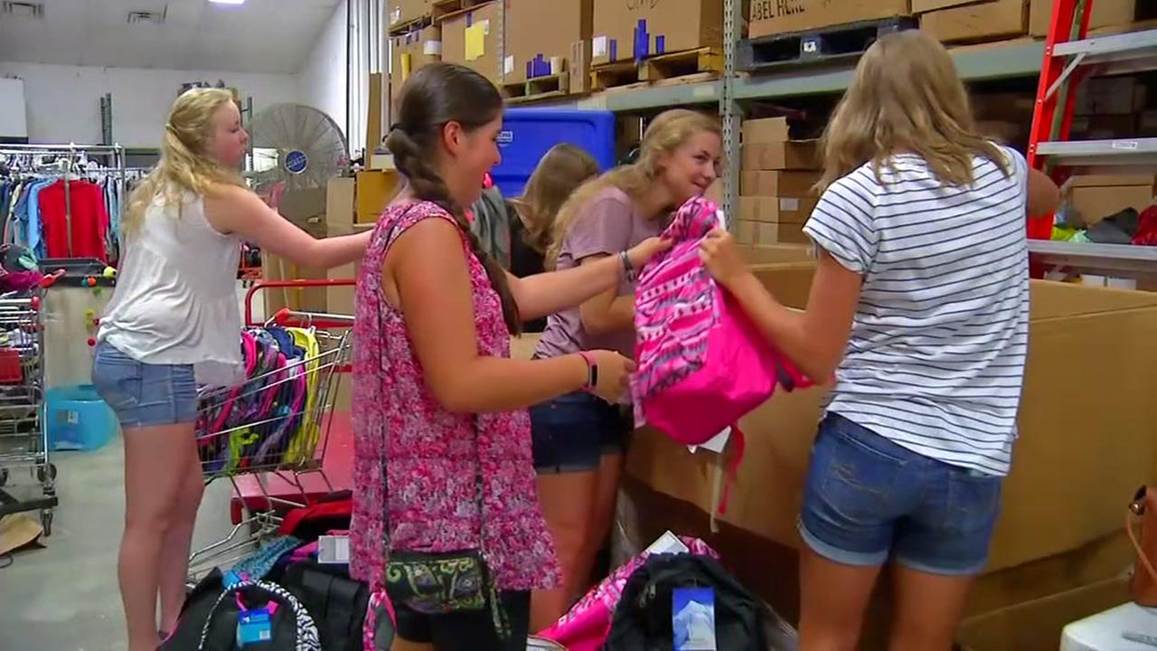 Teen spends birthday stuffing backpacks for kids in need