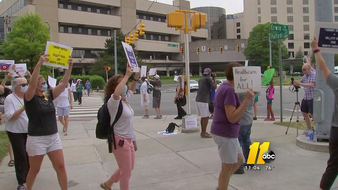 Protesters march outside Duke Hospital