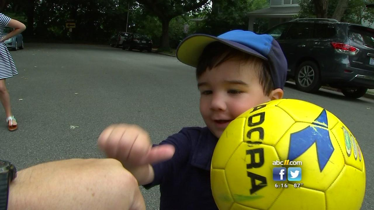 Raleigh boy fist bumps his way to Internet fame