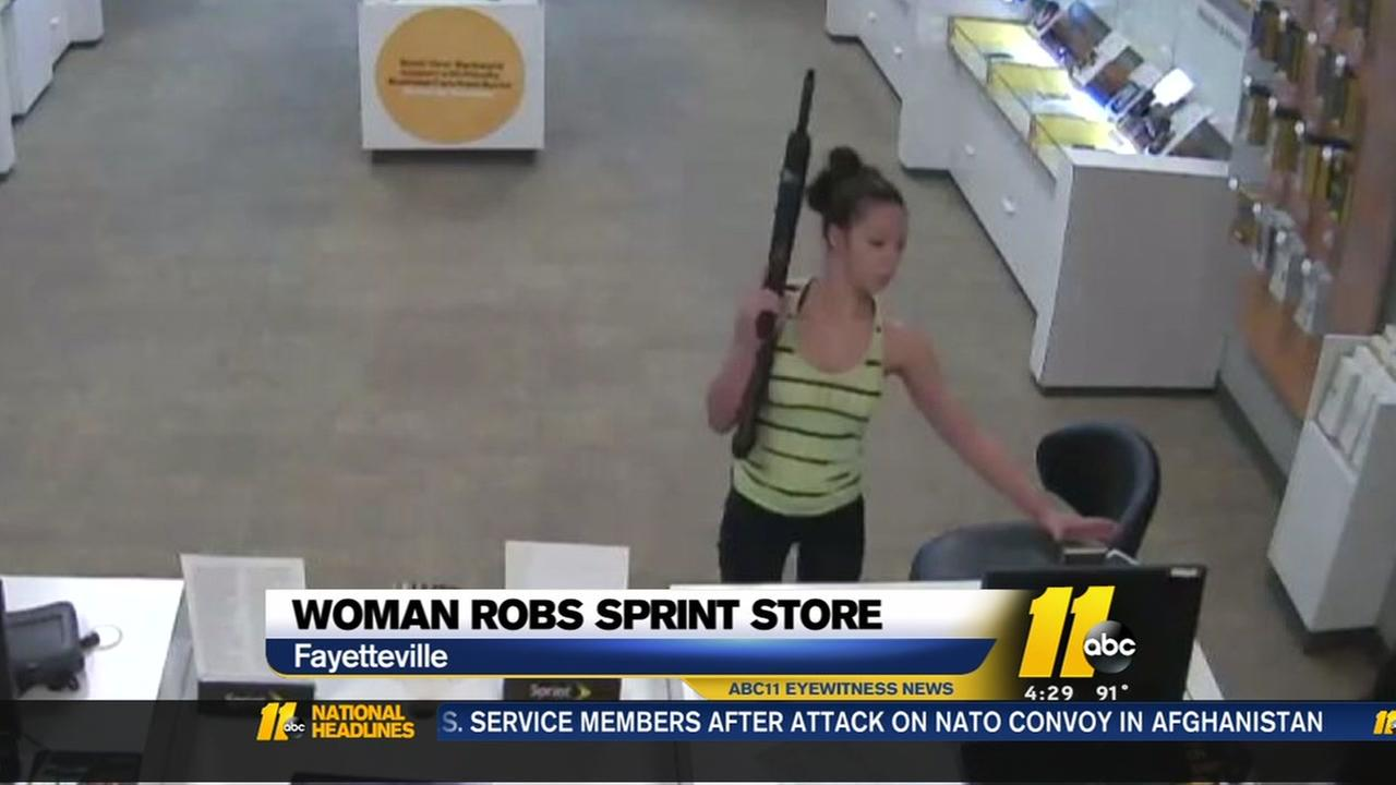 Irate woman with rifle robs NC cellphone store