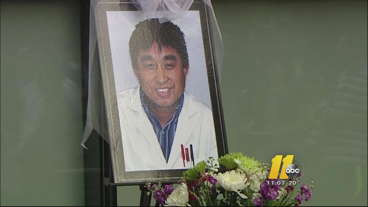 Vigil and memorial held for slain UNC professor