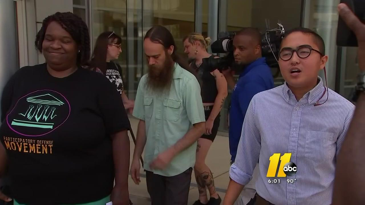 Four protesters arrested, freed on bond