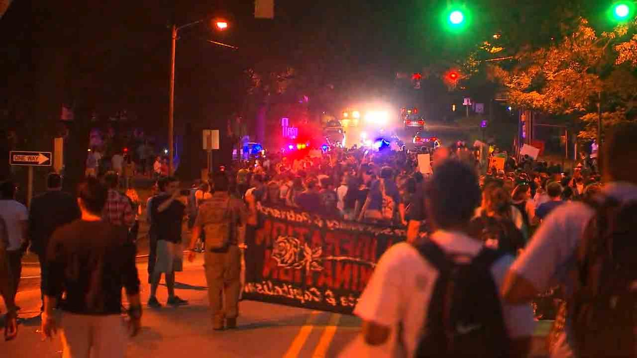 Protesters gather at the Silent Sam statue on Tuesday.