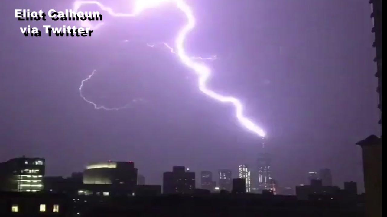New York skyline lights up as lightening strikes Freedom Tower