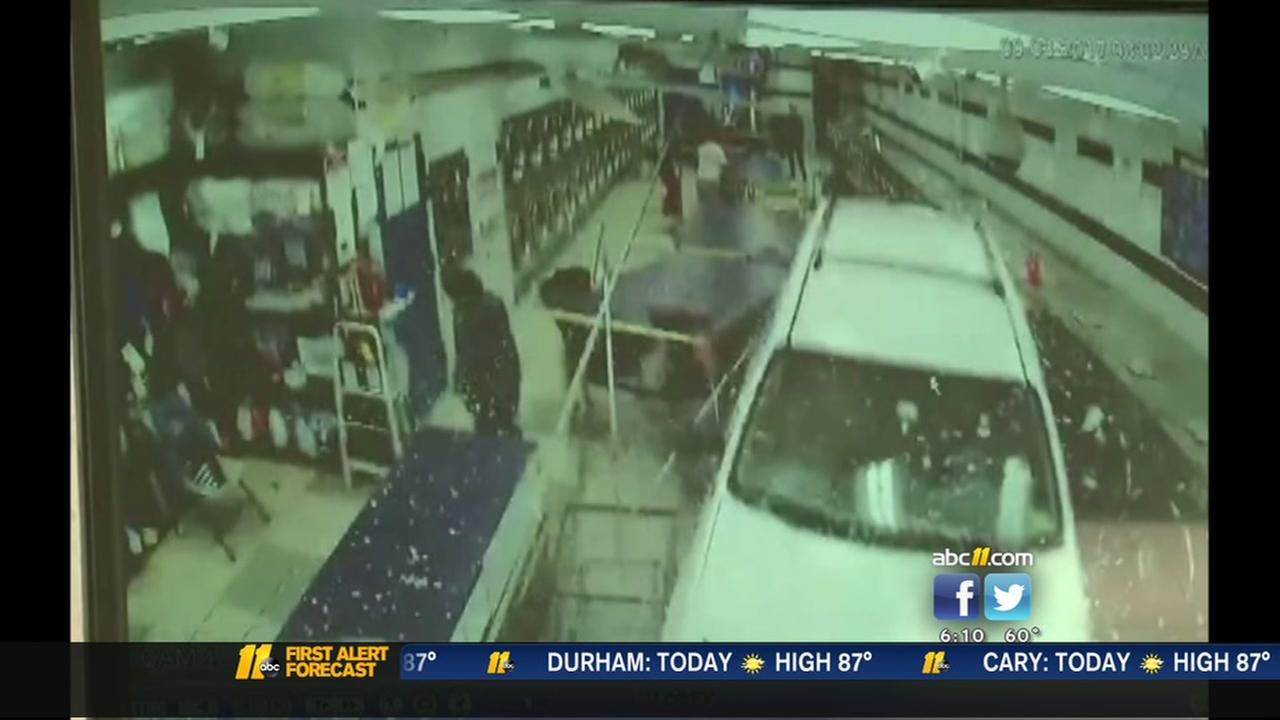 SUV through laundromat