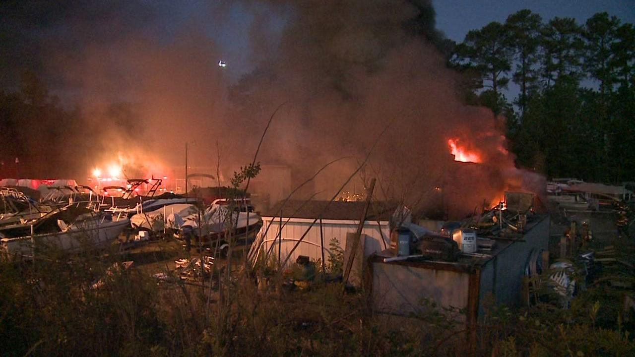 Fire engulfs boats, building at Durham dive shop