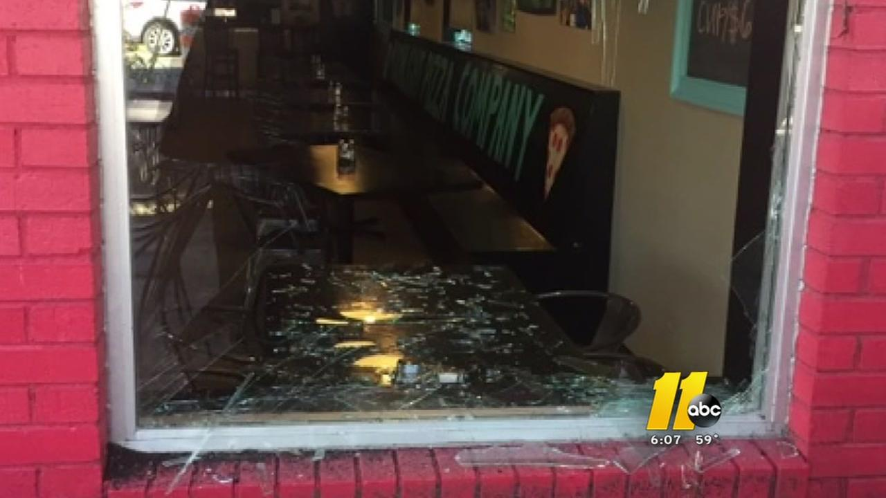 Wayward deer smashes into downtown Raleigh business