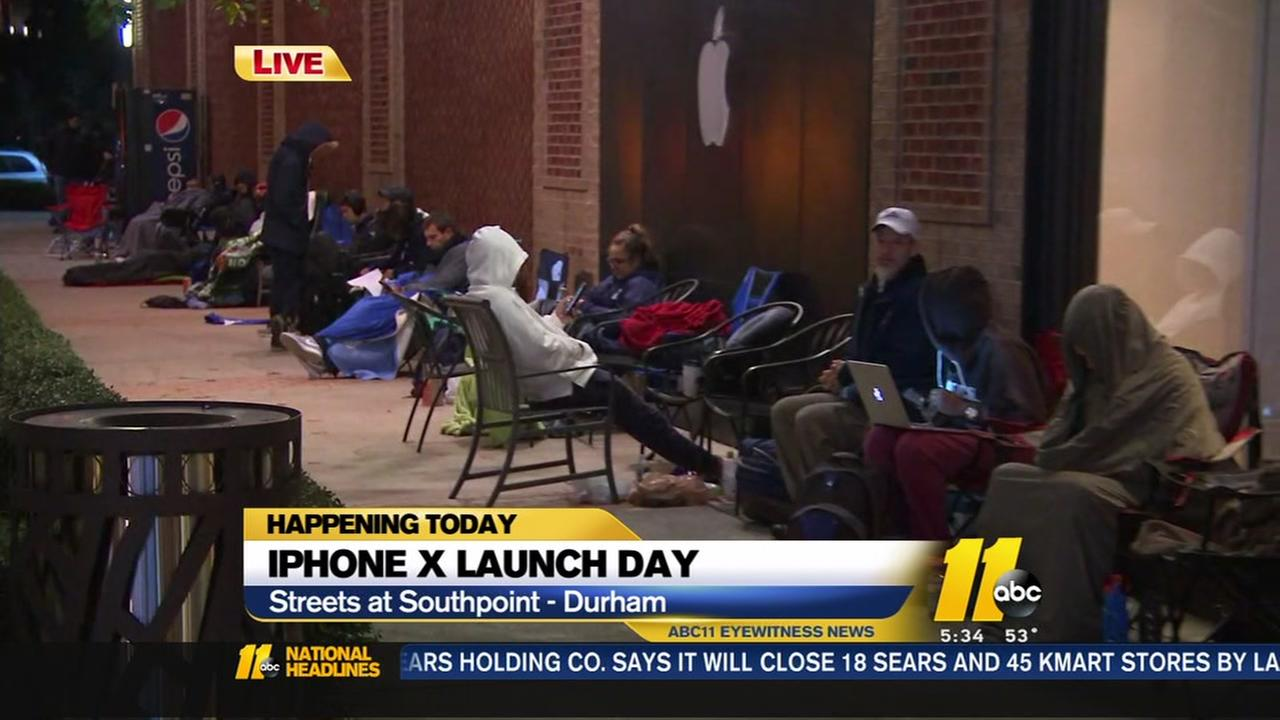 Lines form as new iPhone X hits stores