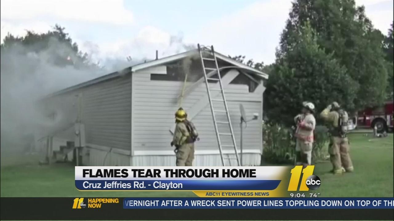 Flames tear through home in Clayton