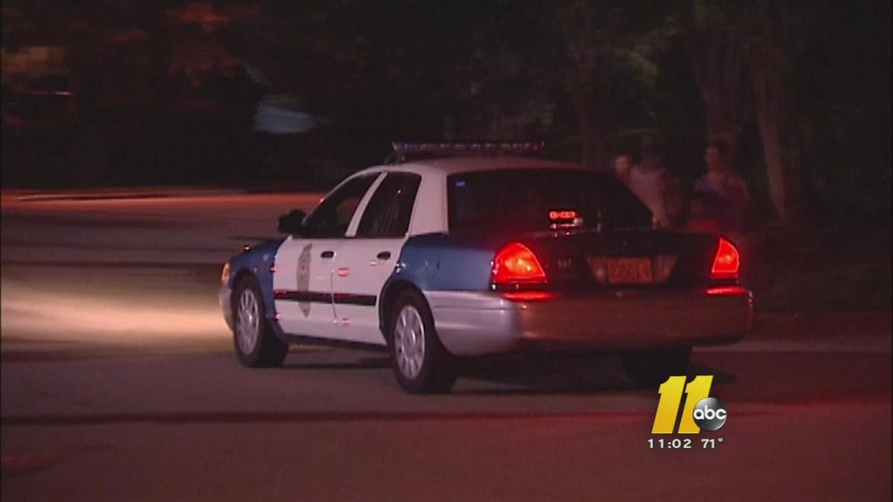 Raleigh police cruiser on dark street