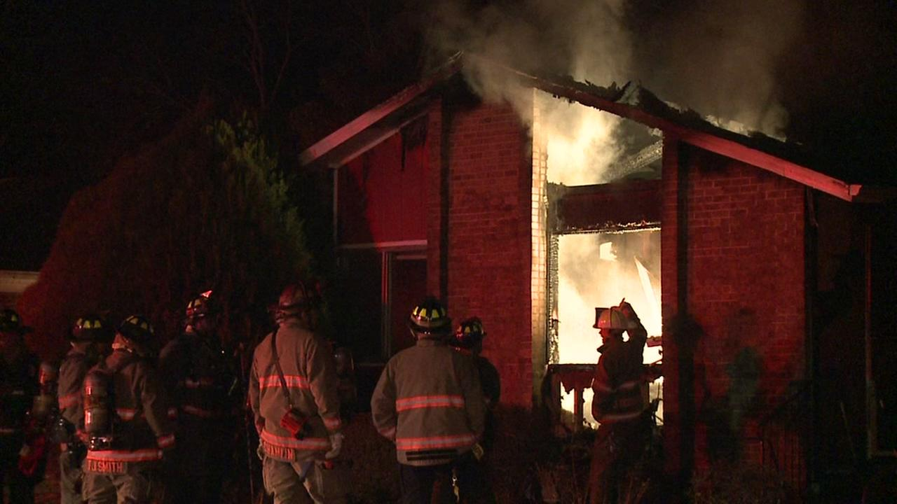 Woman pulled from house fire in Durham