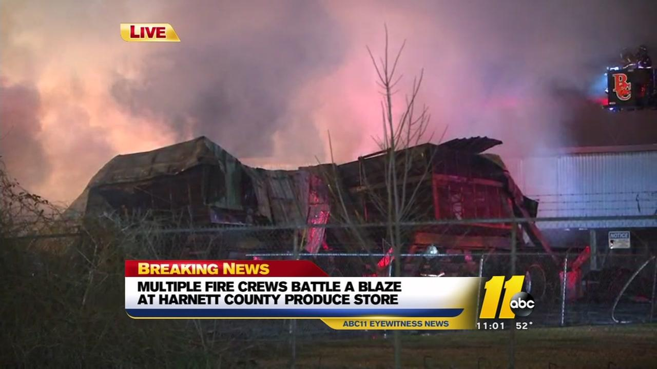 Firefighters battle a blaze at Harnett County produce store