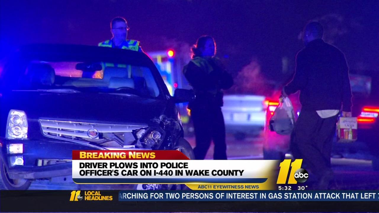 Woman slams into Raleigh patrol car at crash site