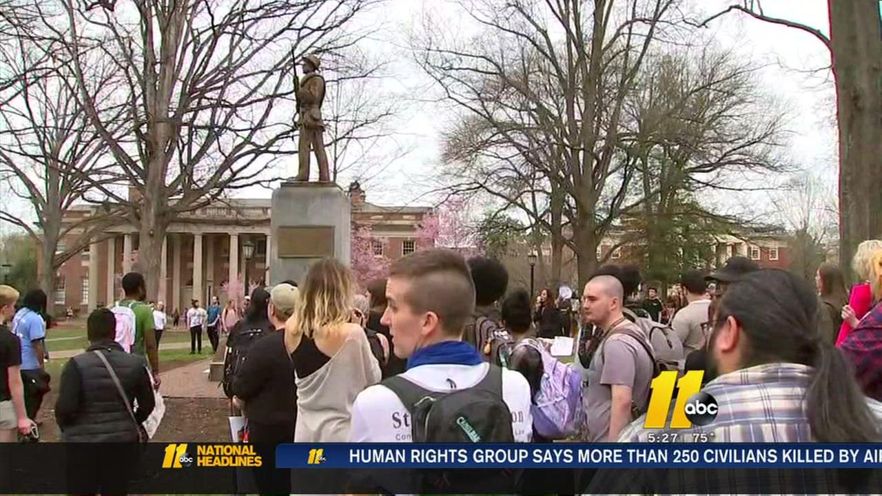 Protesters at UNC gather around Silent Sam statue