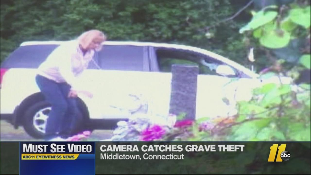 Police say a woman stole a statue from a grave