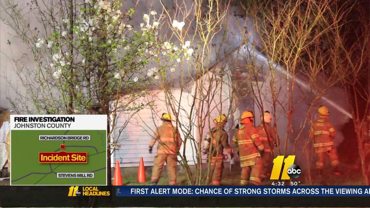 Fire crews battle a house fire in Johnston County