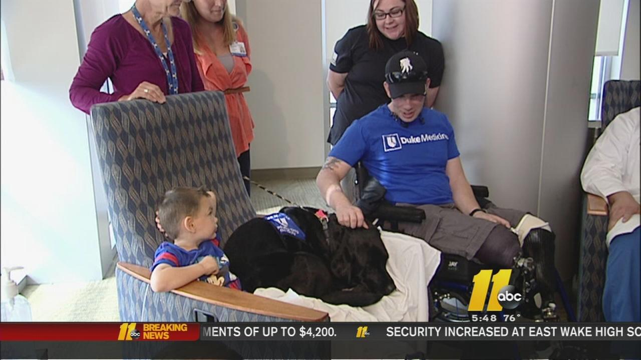 Sgt. Cory Muzzy credits the staff at Duke University Medical Center with saving his life, along with help from his former therapy dog Kylie.