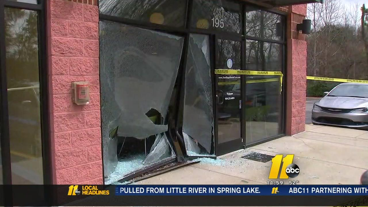 Car plows into Wake County building