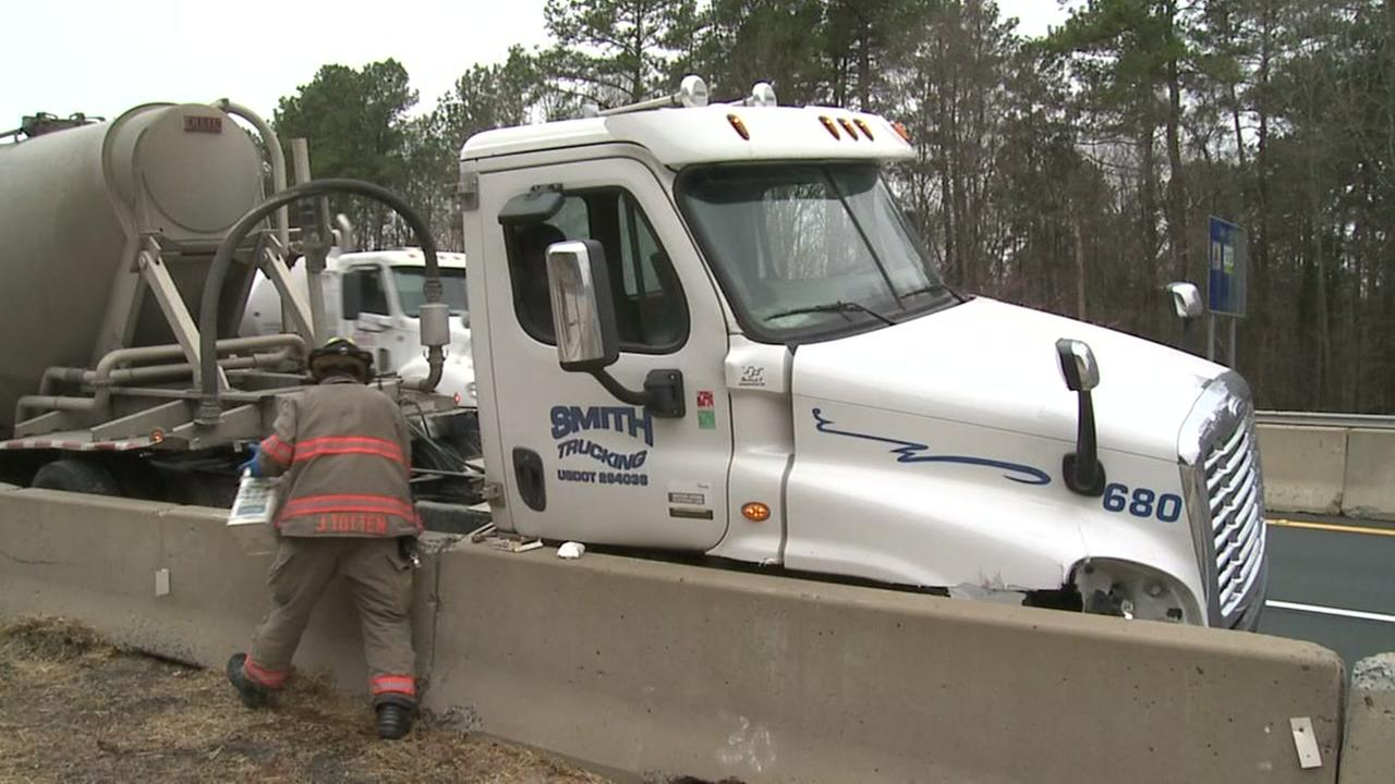 Tractor-trailer driver injured after crashing into barrier on Durham Freeway