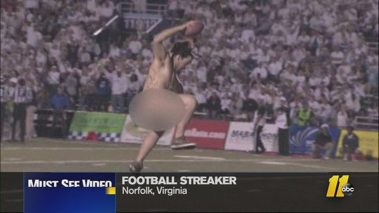 A streaker spikes the ball in the end zone