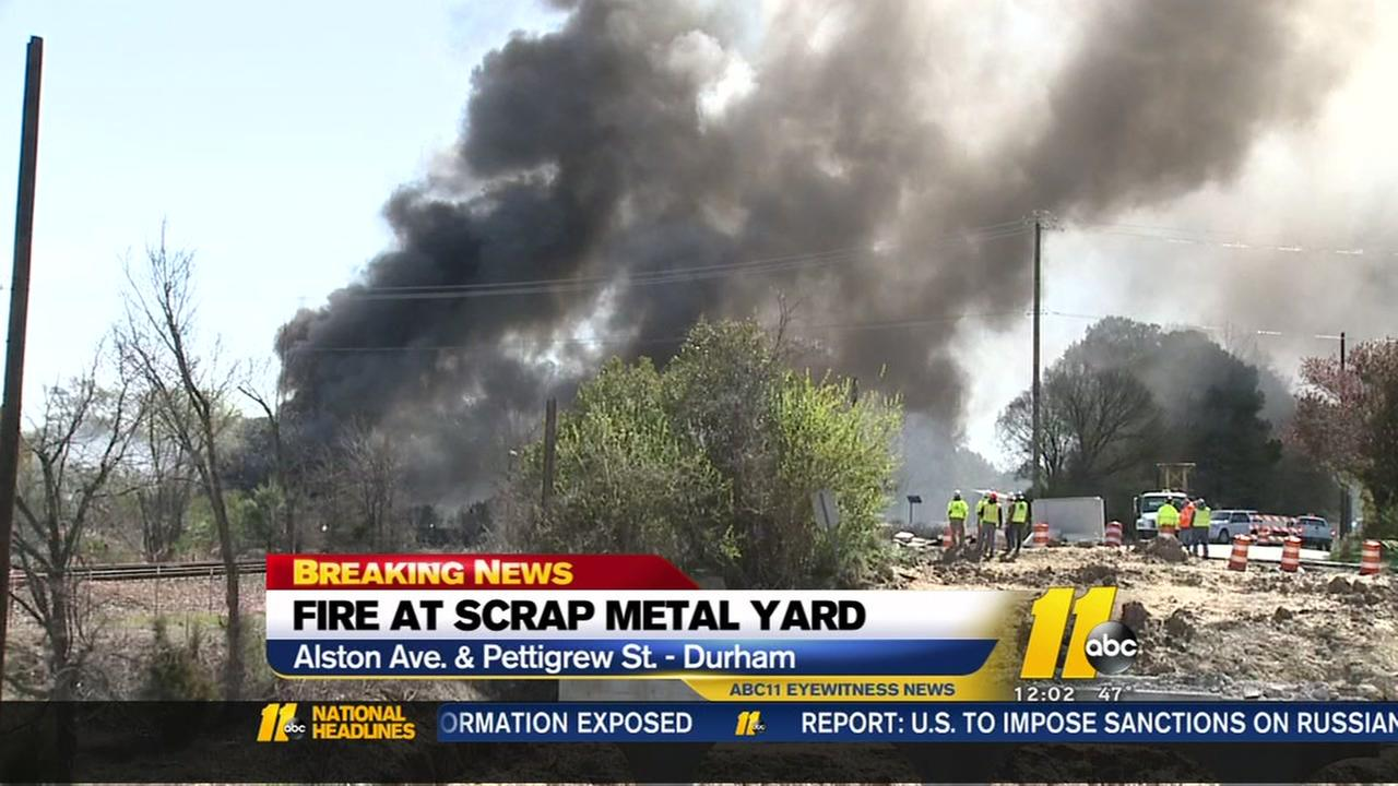 Heavy smoke billows from fire at scrap metal recycling center in downtown Durham