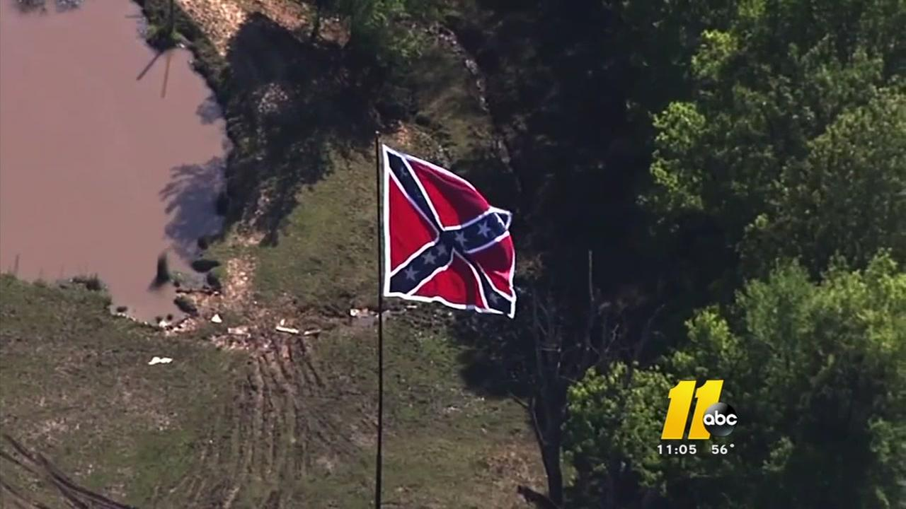 Dozens debate large Confederate flag in Orange County