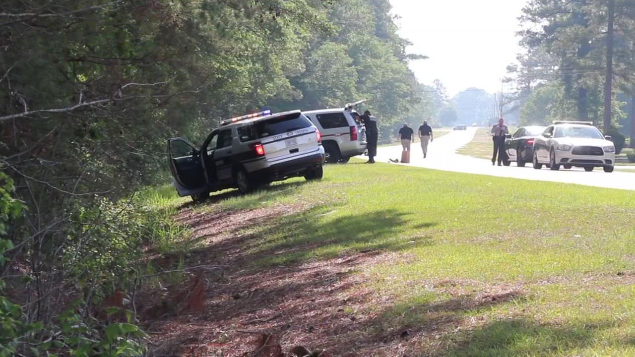 Cumberland County Sherriffs investigating a body found in a ditch