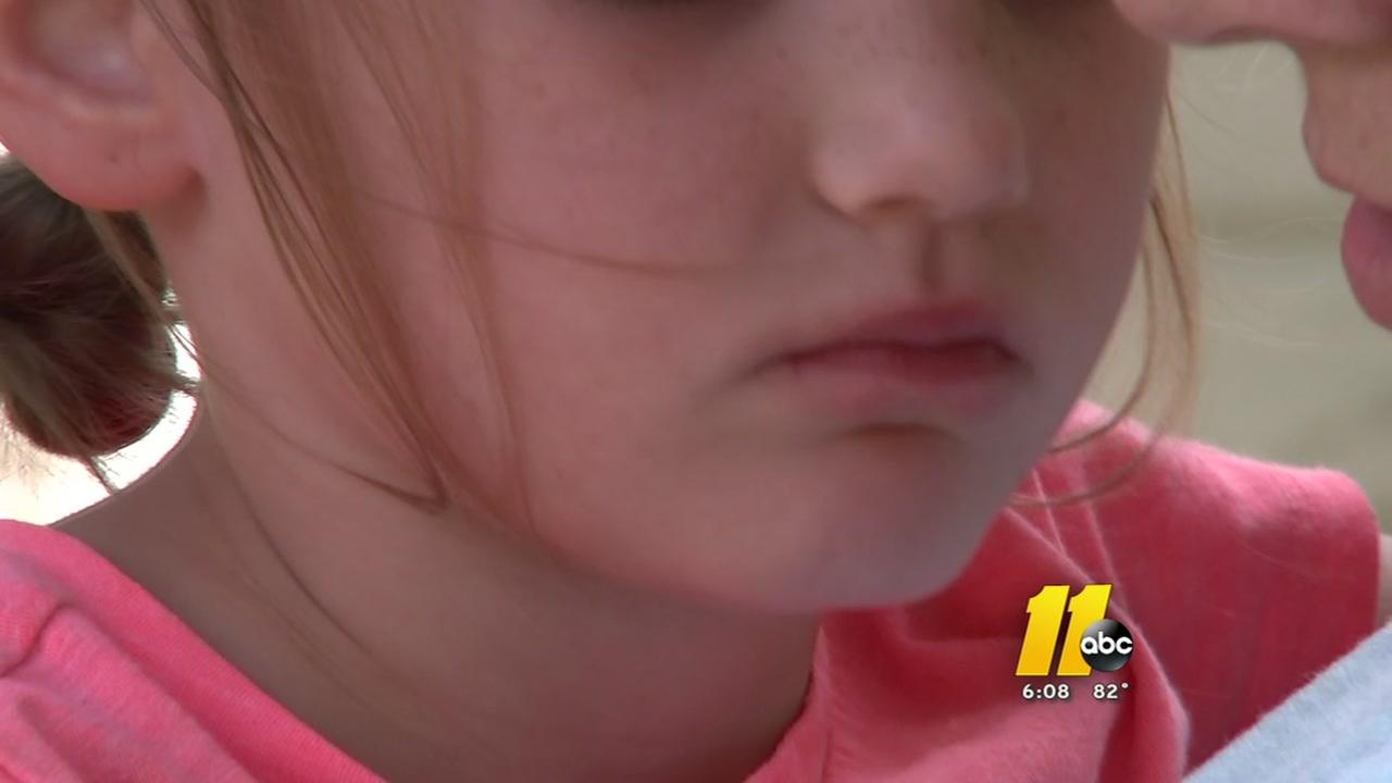 Parents are heated after girl left on school bus for hours.