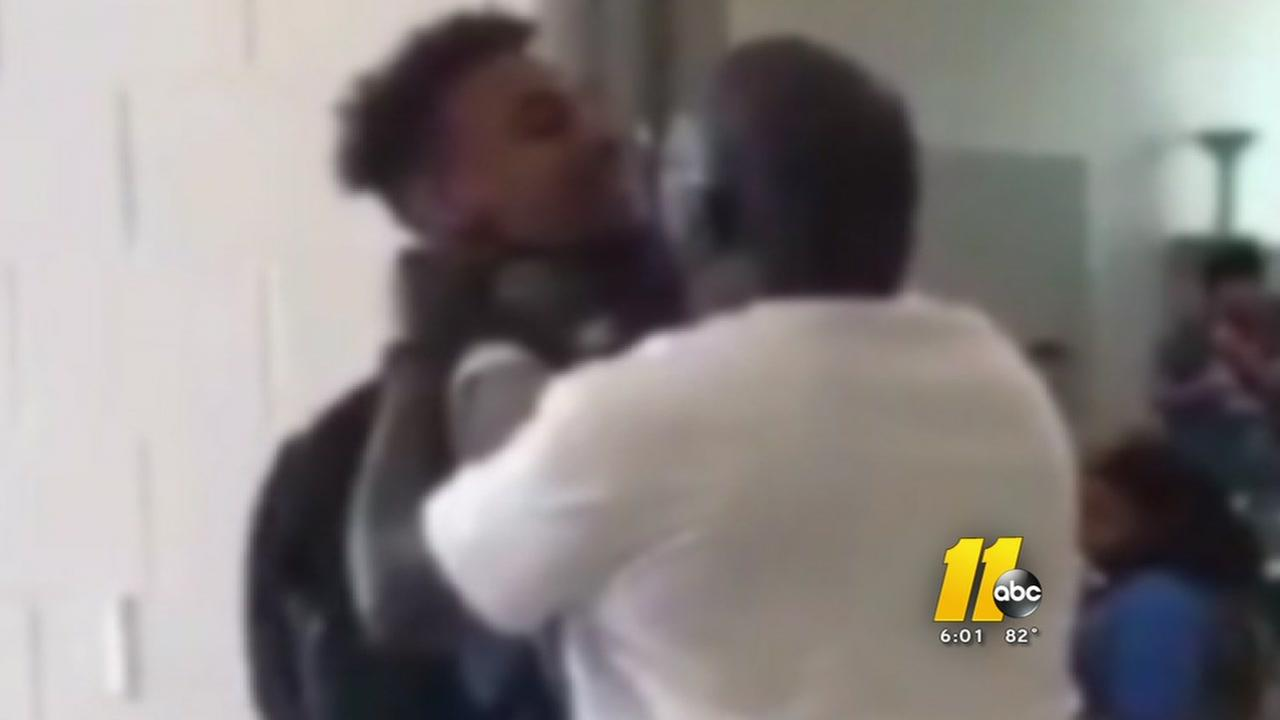 Apex teacher suspended after video of him choking student