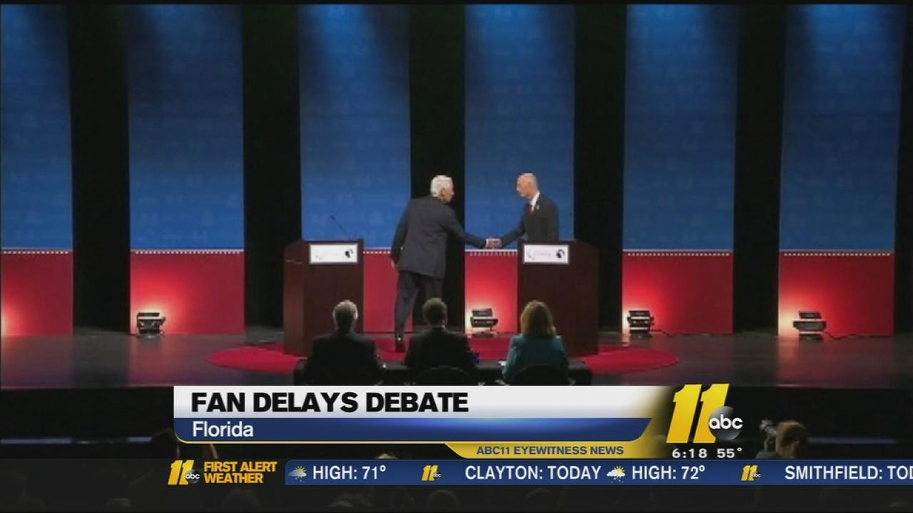 Debate delayed while both sides argue over a fan