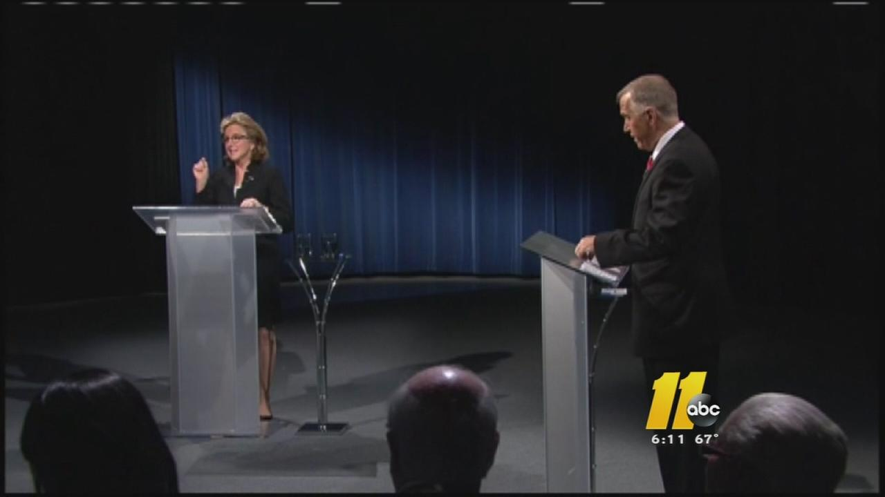 Tillis Hagan debate at podiums