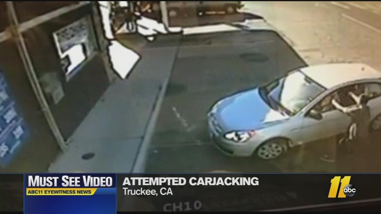The carjacker broke the womans window