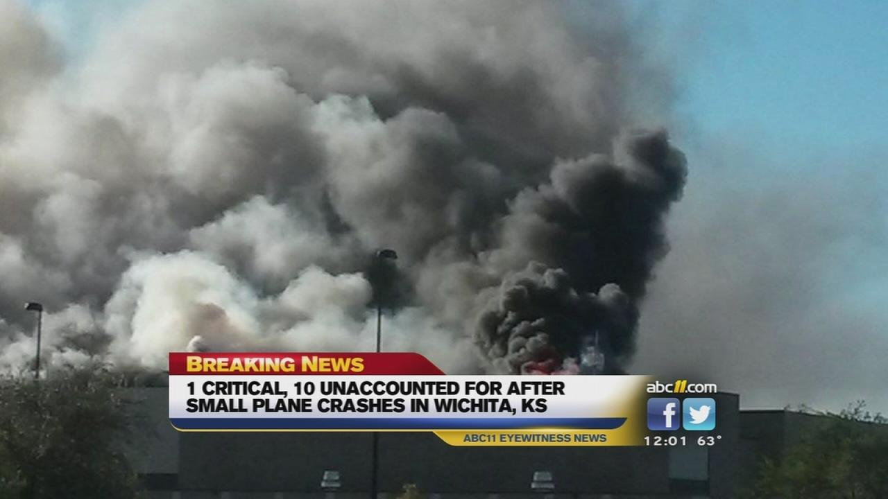 Smoke pours from a building after the plane crash