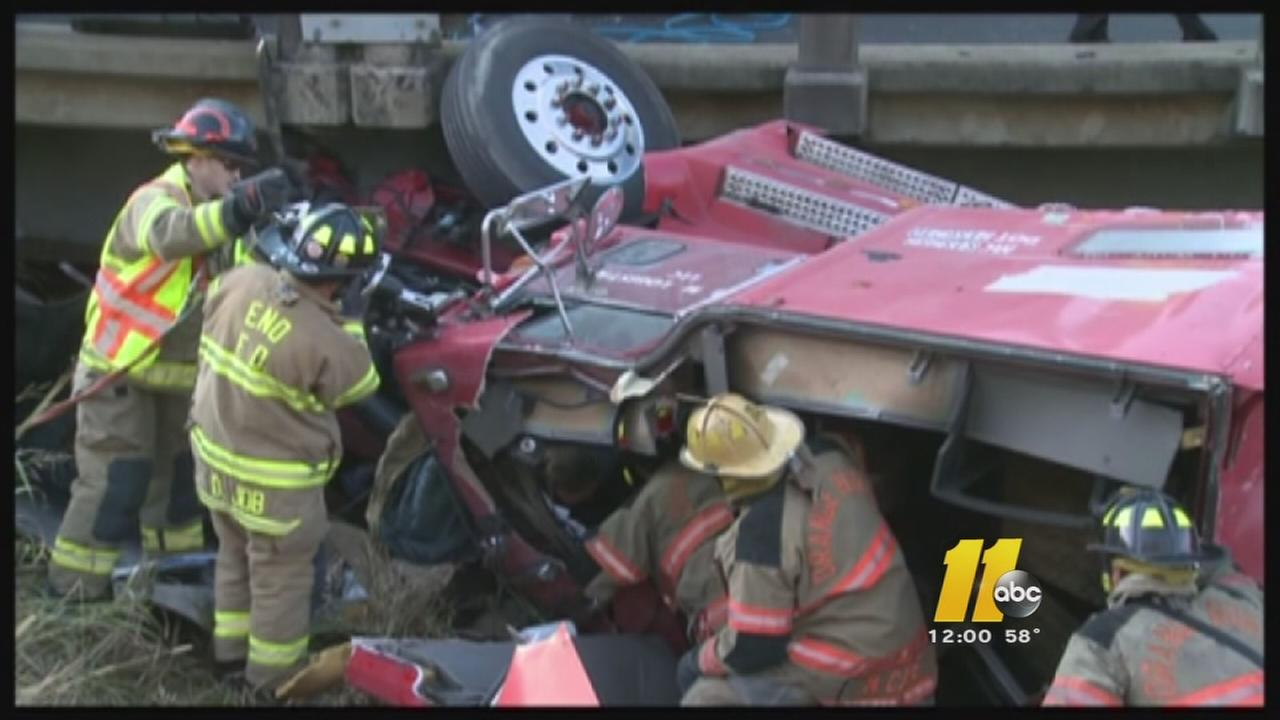 Tractor trailer hits bridge on Hwy 70 under I-85