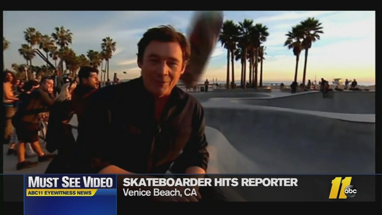 The skate board hit the reporter in the head
