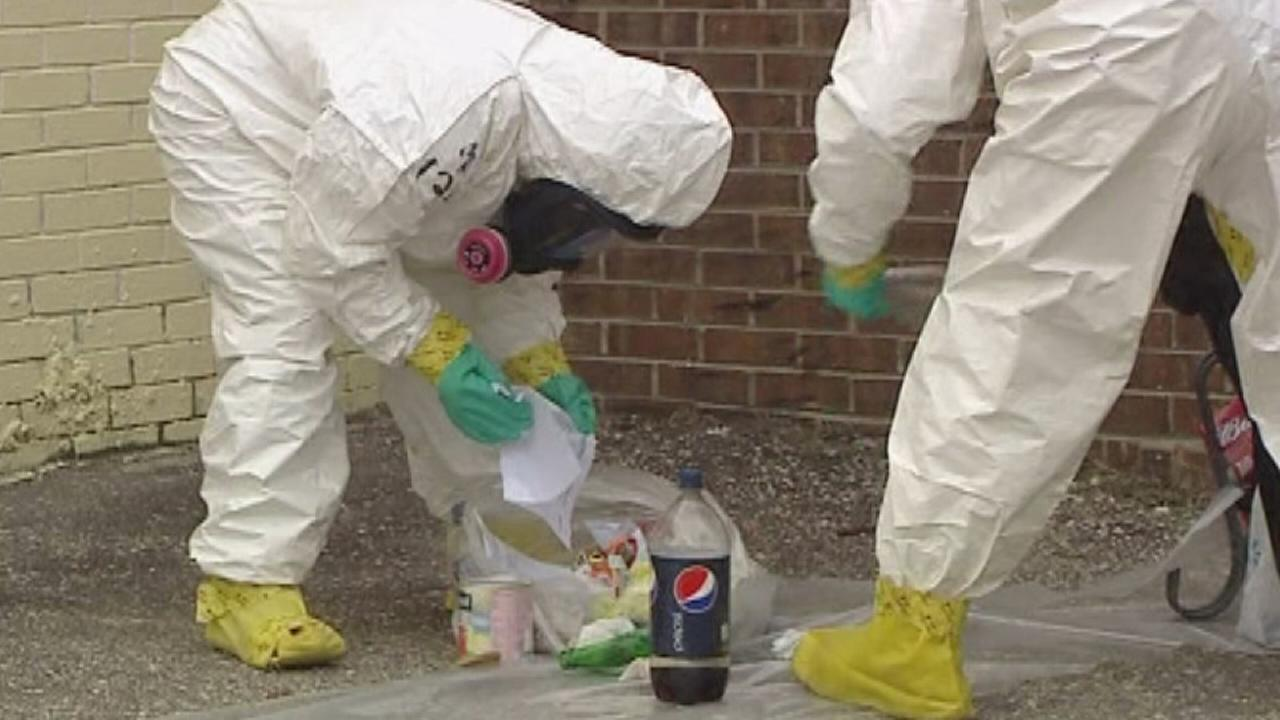 Law enforcement officers at a suspected meth lab