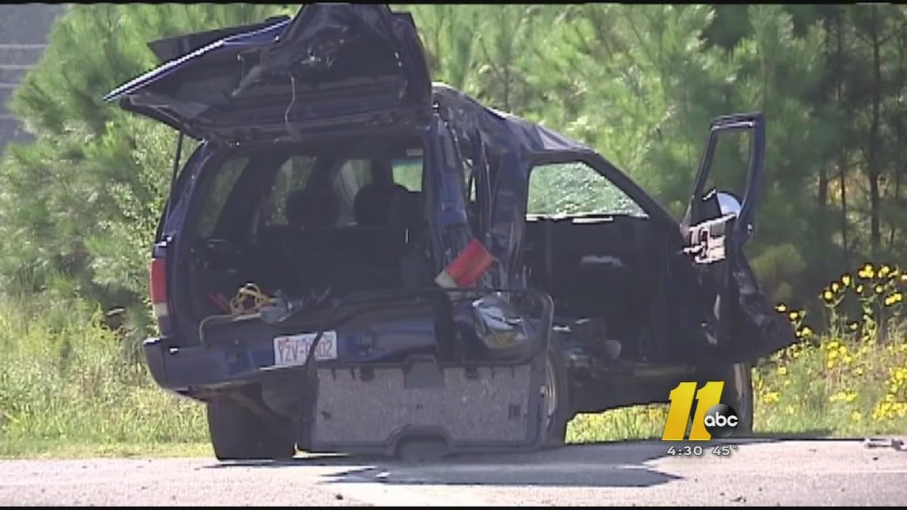 A teen riding in this SUV died when it turned into the path of a dump truck.