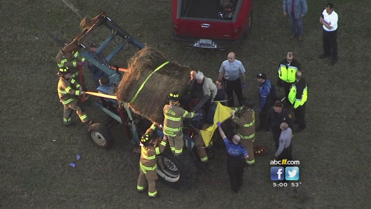 Man trapped by large bale of hay rescued