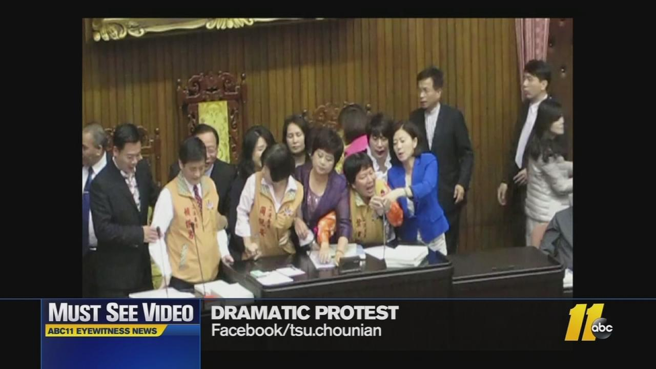 Must-See Videos:  Lawmakers scuffle over microphone
