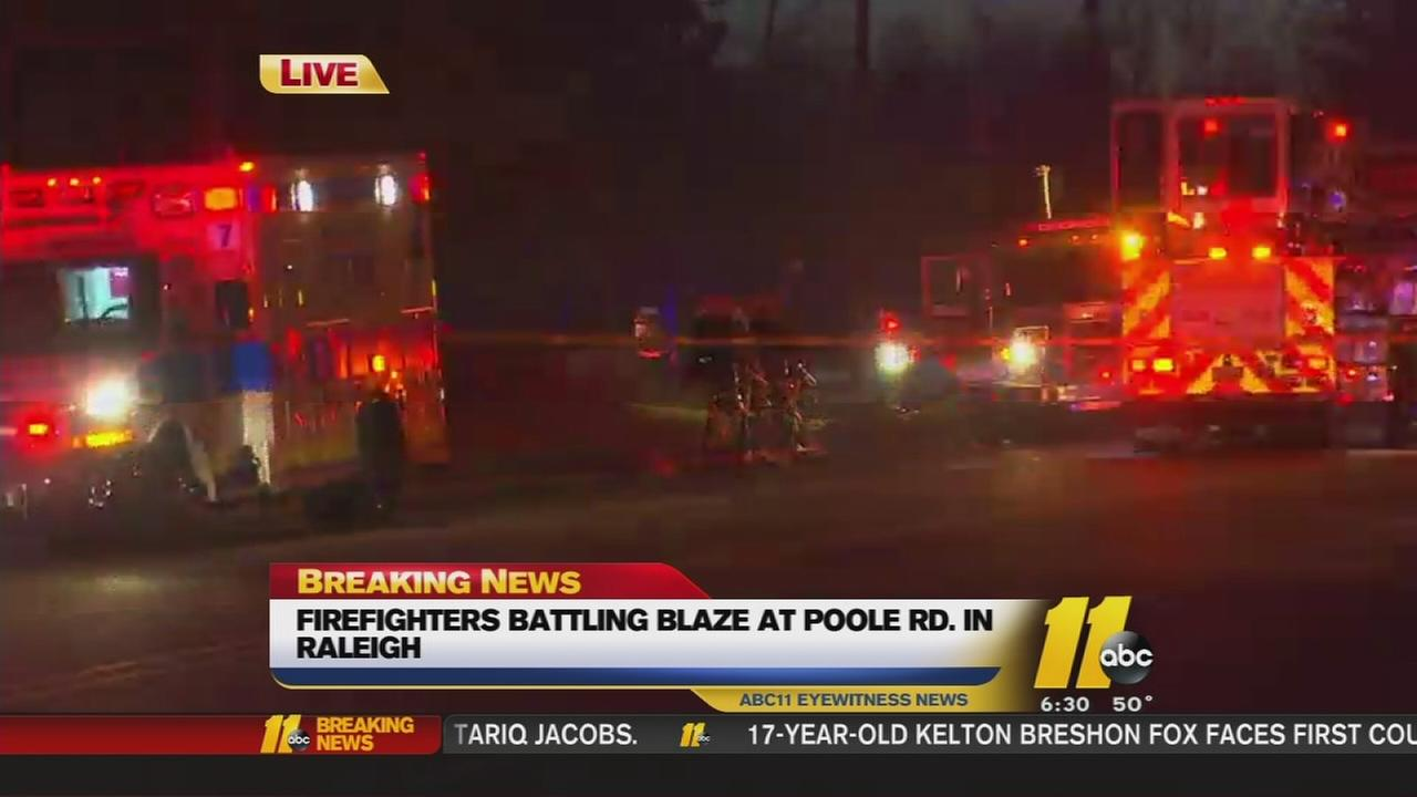Raleigh firefighters battle fire in home