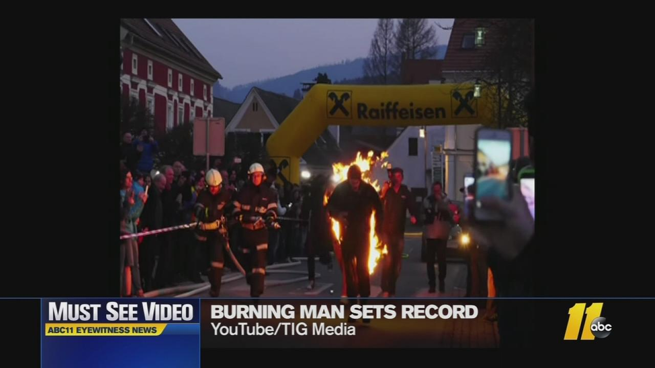 Must-See Videos: Man sets running record - on fire!