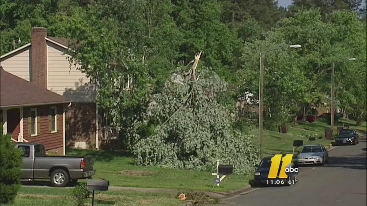 Durham neighborhood cleans up after tornado