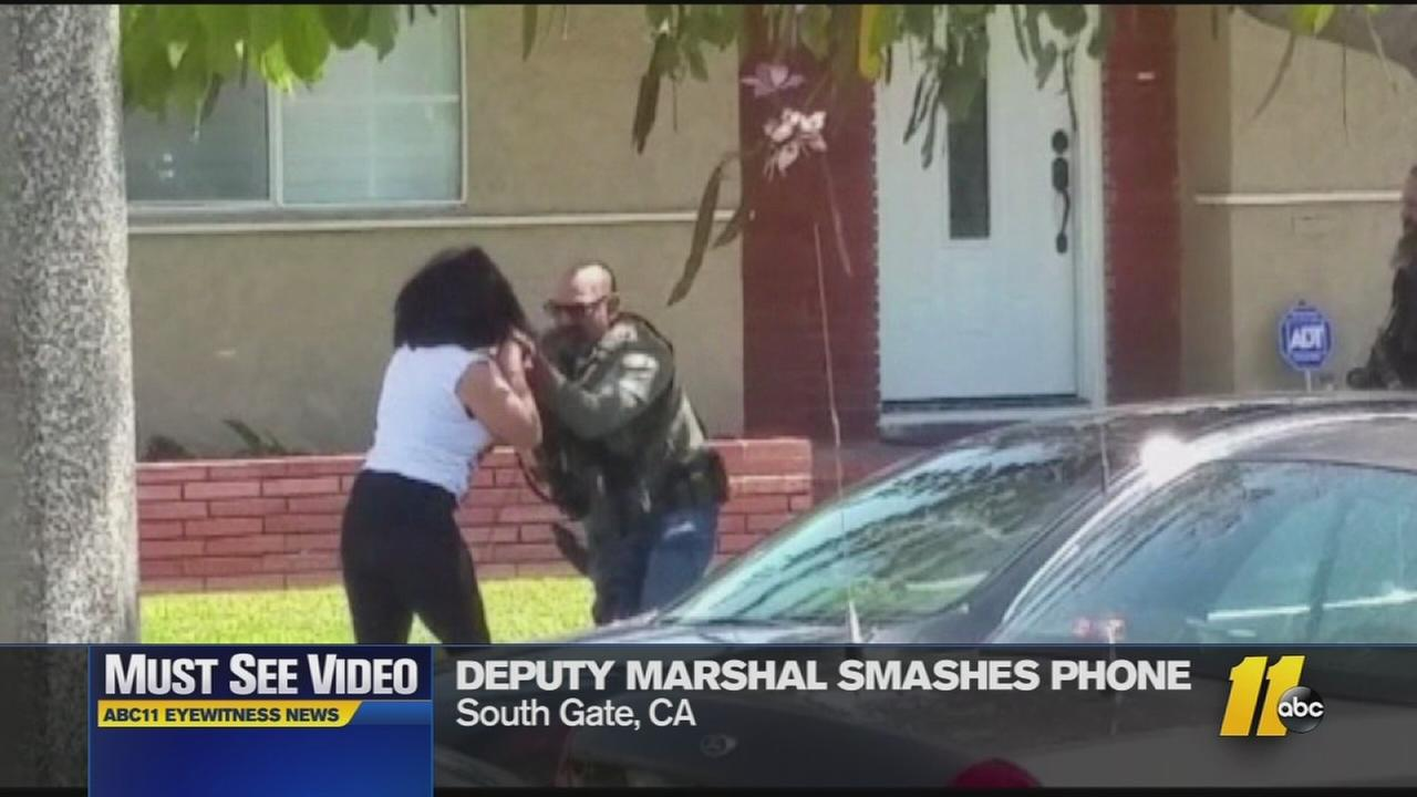 Must-See Videos: U.S. marshal destroys womans phone