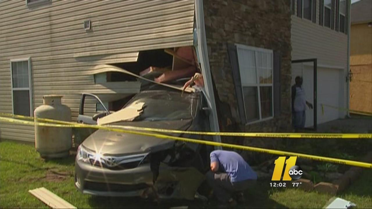 Car slams into Durham home