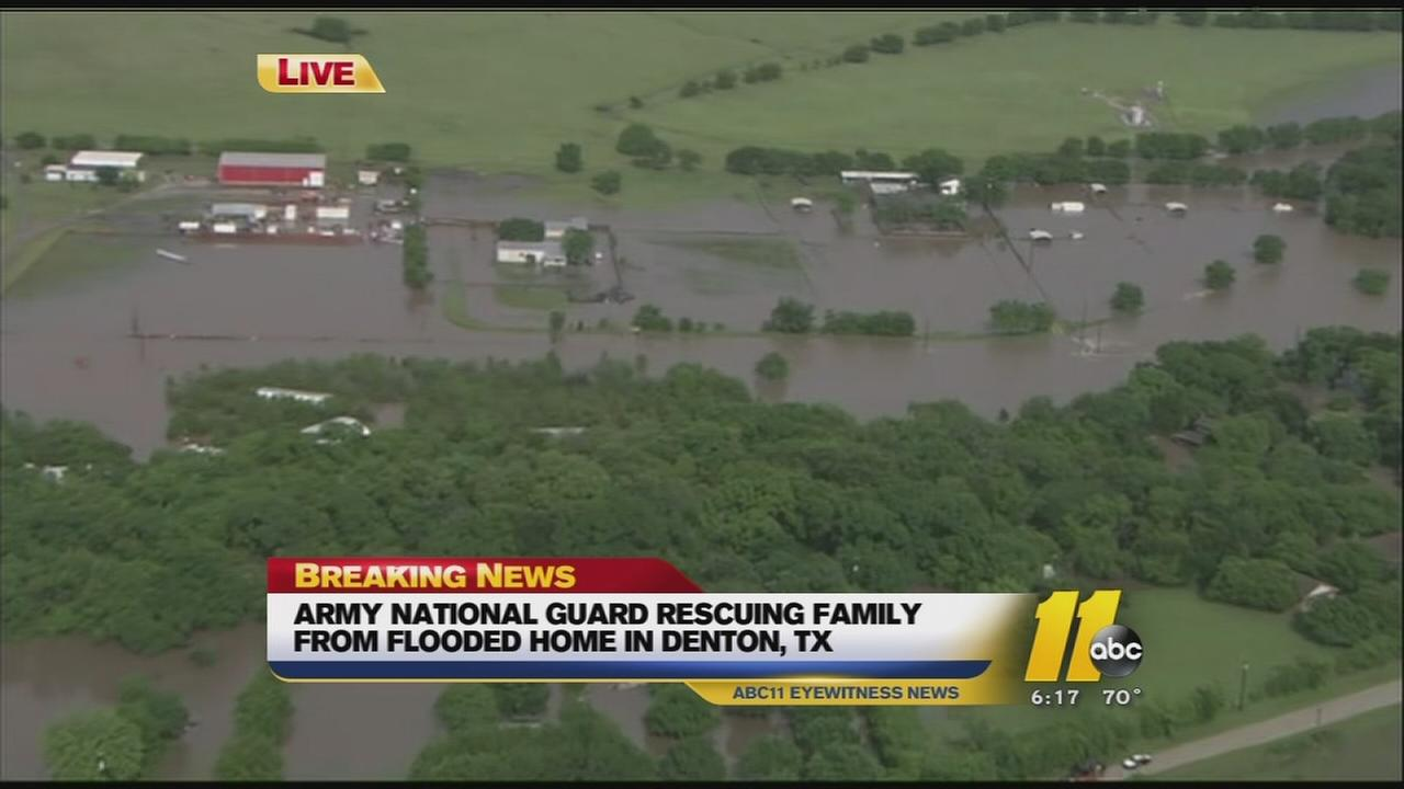 Natl Guard rescuing family from flood