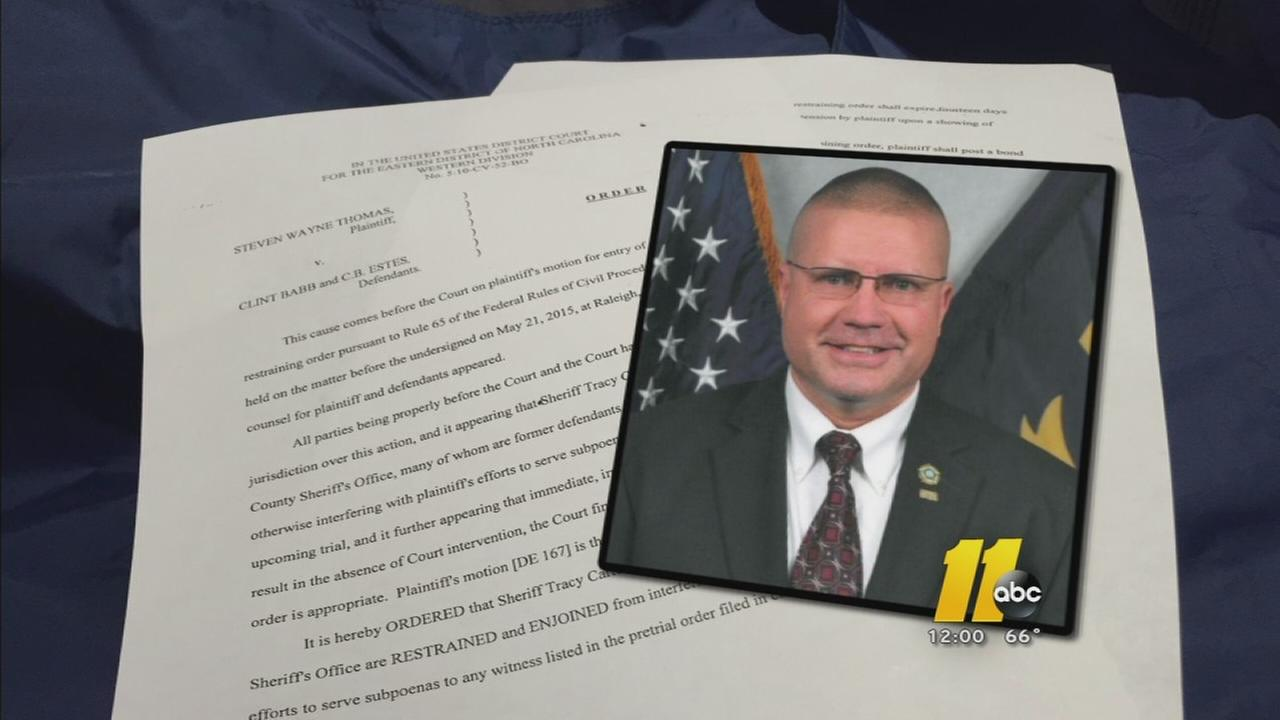 Sheriff accused of arresting man trying to serve subpoena