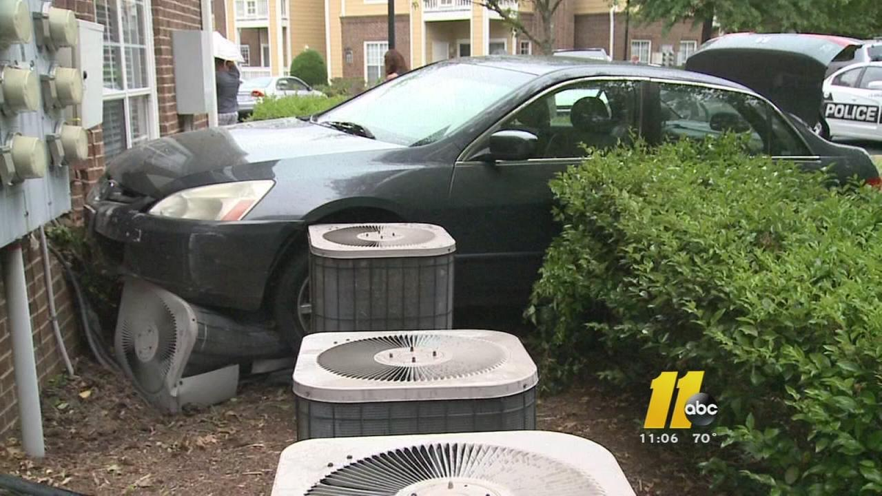 Car strikes Durham apartment building