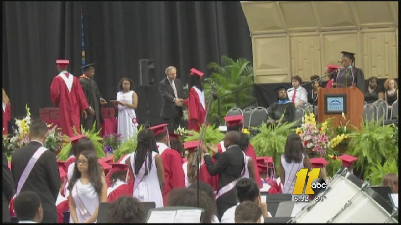 Graduation goes on without principal who was burned
