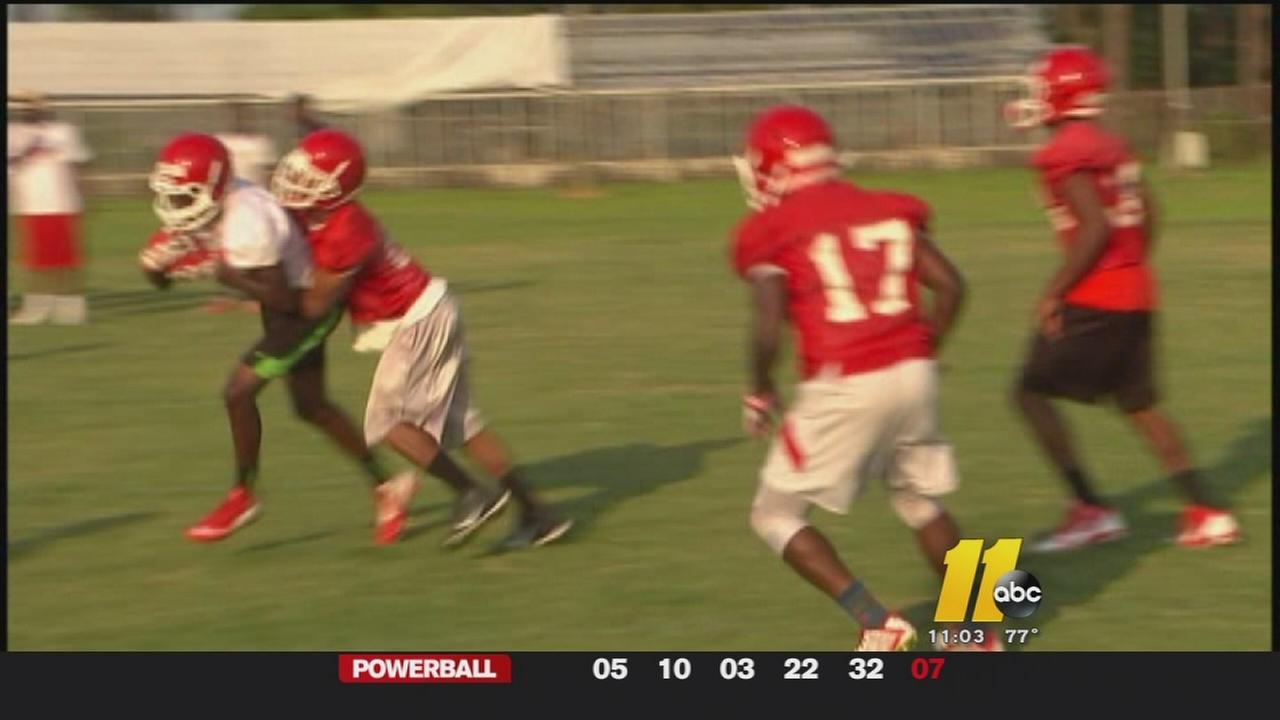 High schools hold football practice in high heat